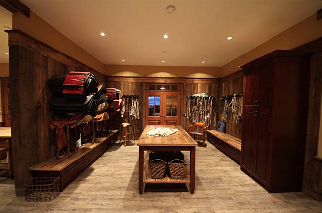 Spacious and stunning wooden tack room