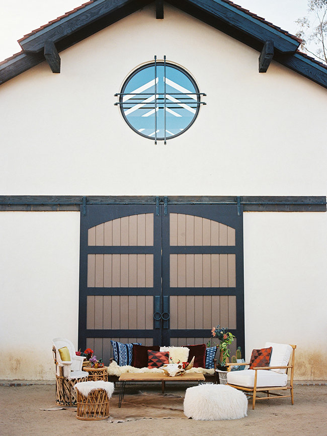 Southwestern and Boho Seating in front of the barn