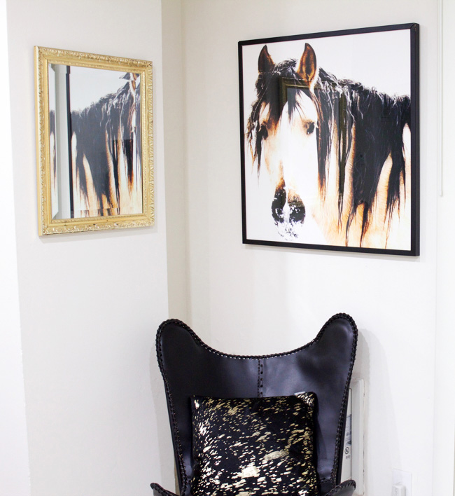 large horse head art plus leather butterfly chair in the corner